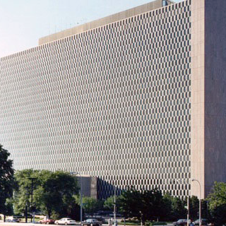 A multi-story building with a checkboard pattern on the exterior