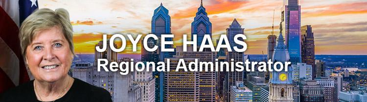 Portrait of Joyce Haas, Region 3 Regional Administrator, with skyline of Philadelphia