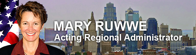 Portrait of Mary Ruwwe, Region 6, acting regional administrator, with Kansas City skyline in the background